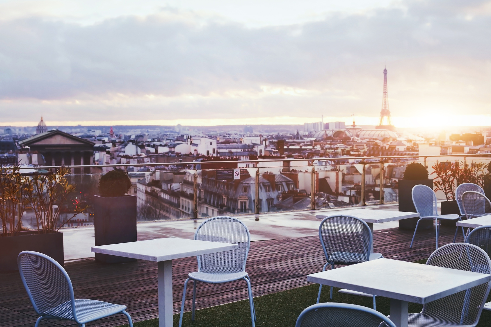 sunny terrace of restaurant in Paris with panoramic view on Eiffel tower, France